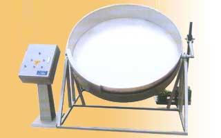 Оборудование для покрытия арахиса какао порошком.